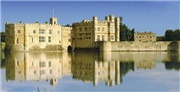 Boutique camping on a vineyard at Leeds Castle, Kent, with a four-poster bed, fur throws and a log-burner